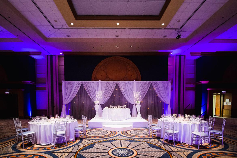 Elegant_Event_Lighting_Chicago_Sheraton_Wedding_Purple_Uplighting_Backdrop_White_Grey_Draping_Crystal_Globe_Backdrop