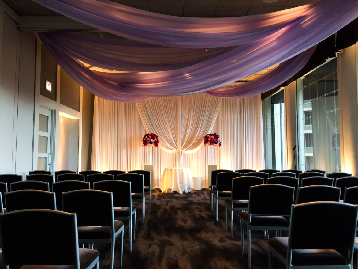 Elegant_Event_Lighting_Chicago_Spiaggia_Wedding_Purple_Uplighting_Cloud_Ceiling_Drapes_Flower