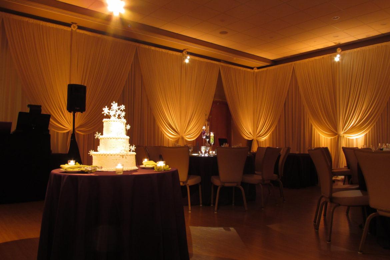 Elegant_Event_Lighting_Chicago_The_Morton_Arboretum_Lisle_Thornhill-Auditorium_Wedding_Ivory_Draping_Amber_Uplighting_Celiling_Drapes