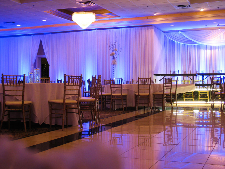 Elegant_Event_Lighting_Chicago_The_Seville_Streamwood_Wedding_Blue_Uplighting_White_Backdrop_Room_Draping