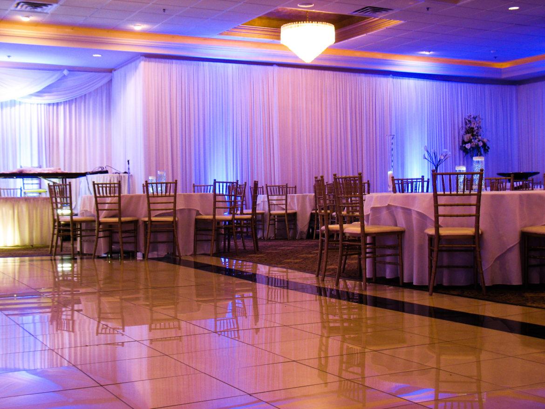 Elegant_Event_Lighting_Chicago_The_Seville_Streamwood_Wedding_Blue_Uplighting_White_Backdrop_Room_Draping_Flower