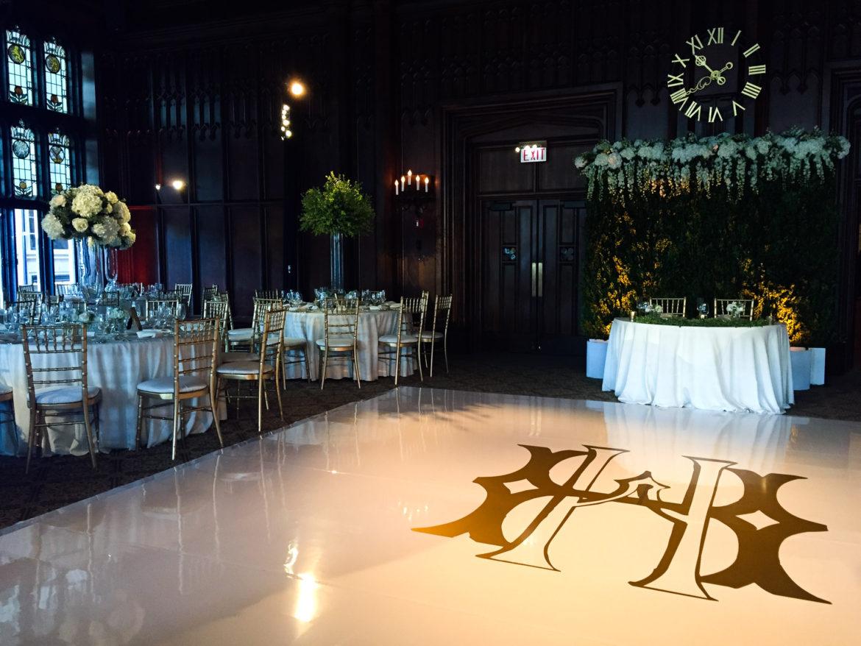 Elegant_Event_Lighting_Chicago_University_Club_Of_Chicago_Michigan_Wedding_White_Vinyl_Dance_Floor_Gold_Monogram