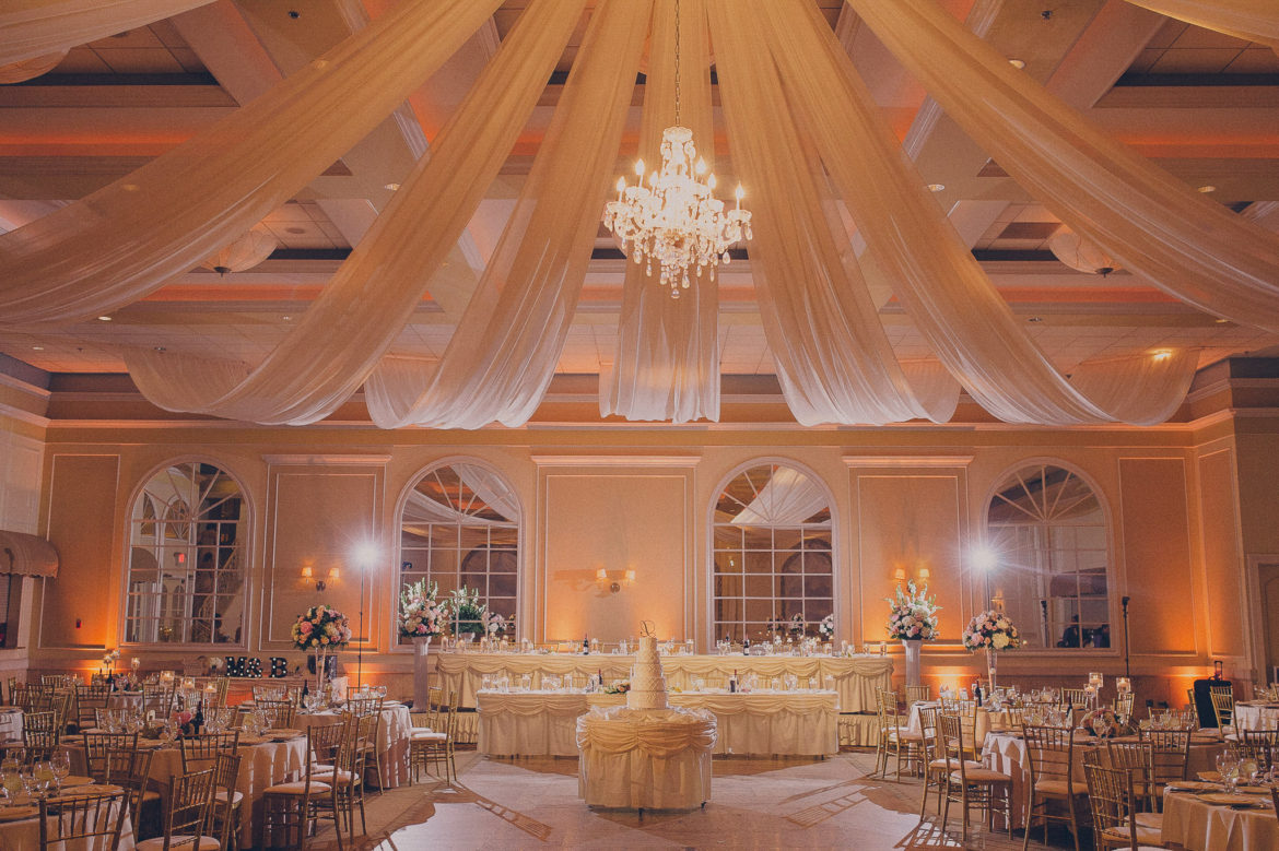 Elegant_Event_Lighting_Chicago_Venutis_Addison_Wedding_Amber_Uplighting_Ceiling_Drapes_Crystal_Chandelier_Flower