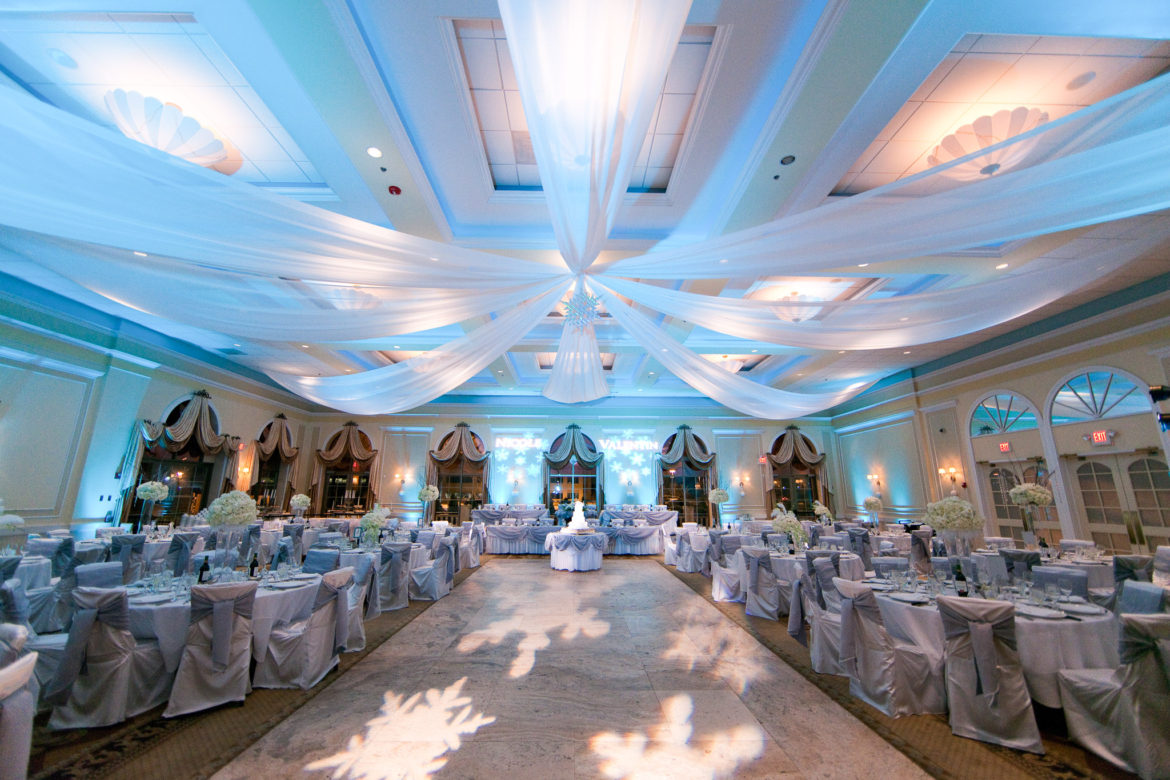 Elegant_Event_Lighting_Chicago_Venutis_Addison_Wedding_Blue_Uplighting_Dance_Floor_Monogram_Ceiling_Drapes_Snowflake