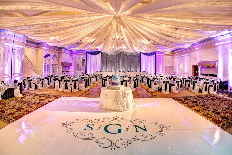 Elegant_Event_Lighting_Chicago_Venutis_Addison_Wedding_Crystal_Backdrop_Glitter_Purple_LED_Uplighting_Ceiling_Drapes_Chandelier_White_Dance_Floor_Monogram