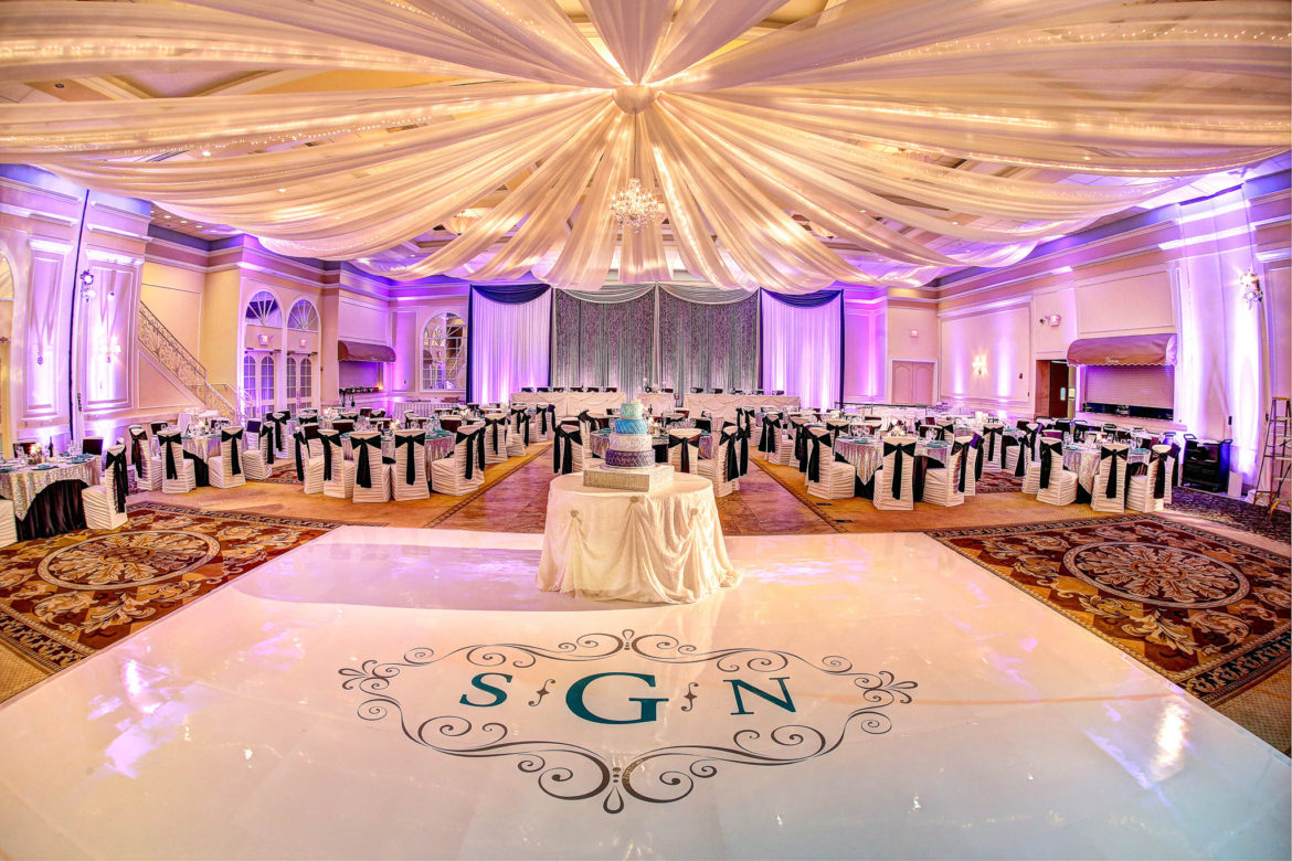 Elegant_Event_Lighting_Chicago_Venutis_Addison_Wedding_Crystal_Backdrop_Purple_Uplighting_White_Vinyl_Dance_Floor_Monogram_Ceiling_Drapes_Chandelier_Crystal_Curtain
