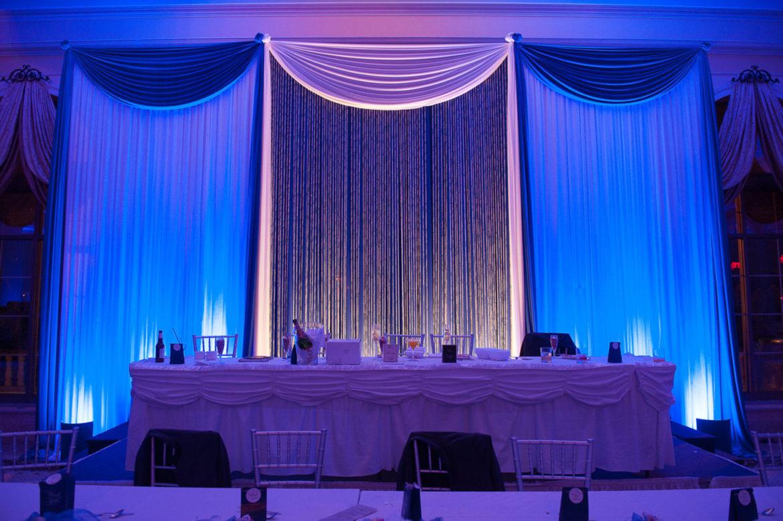 Elegant_Event_Lighting_Chicago_Venutis_Addison_Wedding_Crystal_Curtain_Backdrop_White_Blue_LED_Uplighting