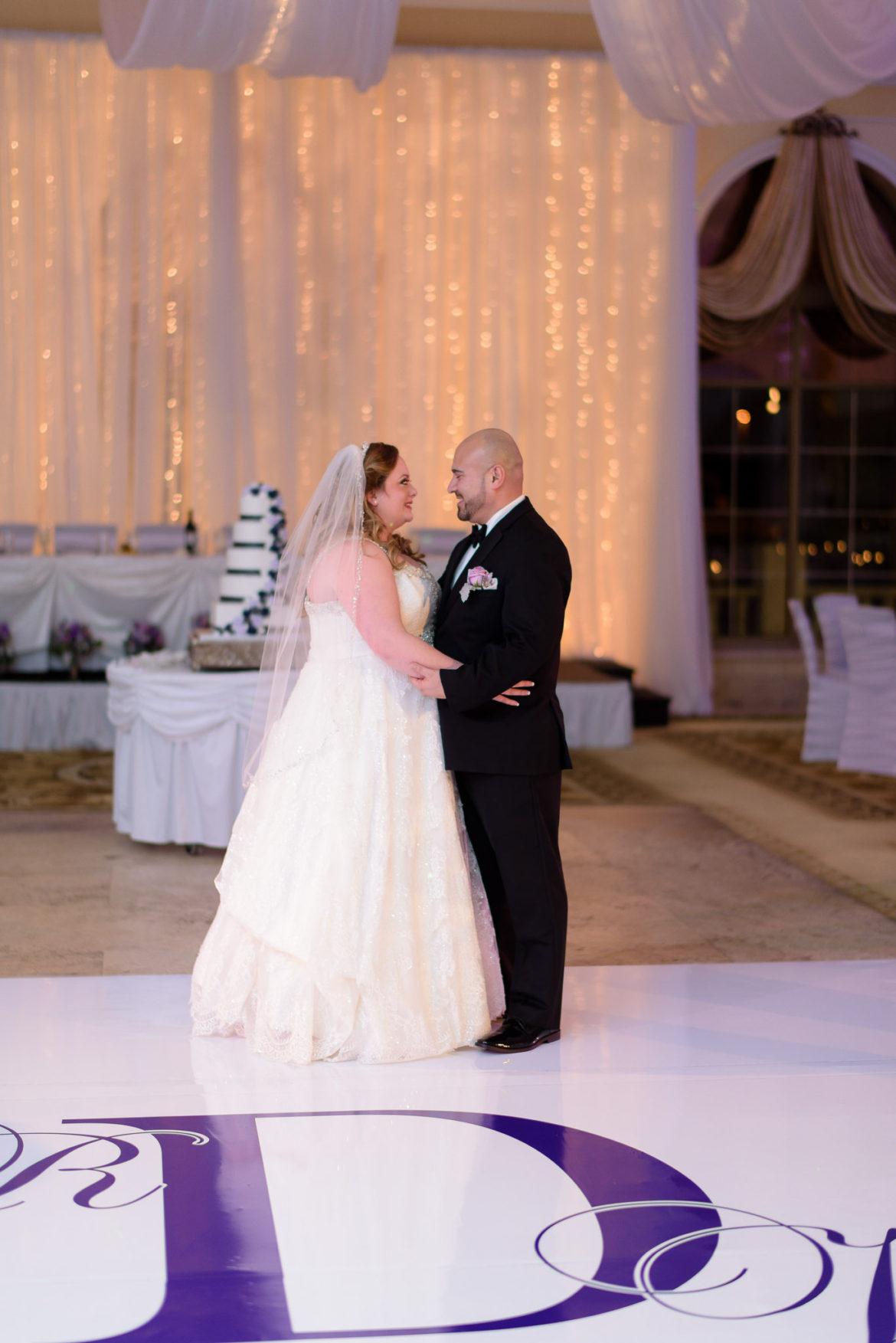 Elegant_Event_Lighting_Chicago_Venutis_Addison_Wedding_Dance_White_Dance_Floor_Twinkle_Light_Backdrop