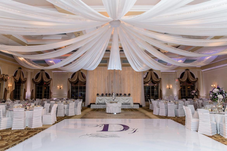 Elegant_Event_Lighting_Chicago_Venutis_Addison_Wedding_Reception_White-Dance_FLoor_Purple_Dance_Floor_Ceiling_Drapes_Twinkle_Lights_Backdrop