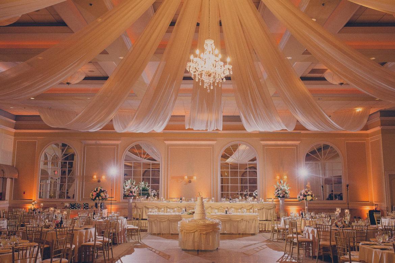 Elegant_Event_Lighting_Chicago_Venutis_Addison_Wedding_Vintage_Crystal_Chandlier_Ceiling_Drape_Romantic_Amber_LED_UPlighting