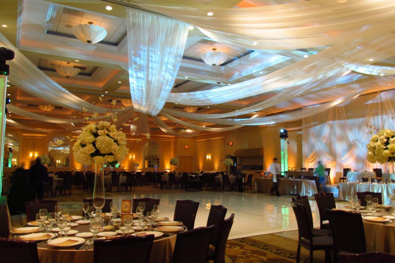 Elegant_Event_Lighting_Chicago_Venutis_Addison_Wedding_White_Ceiling_Drapes_Amber_LED_Uplighting