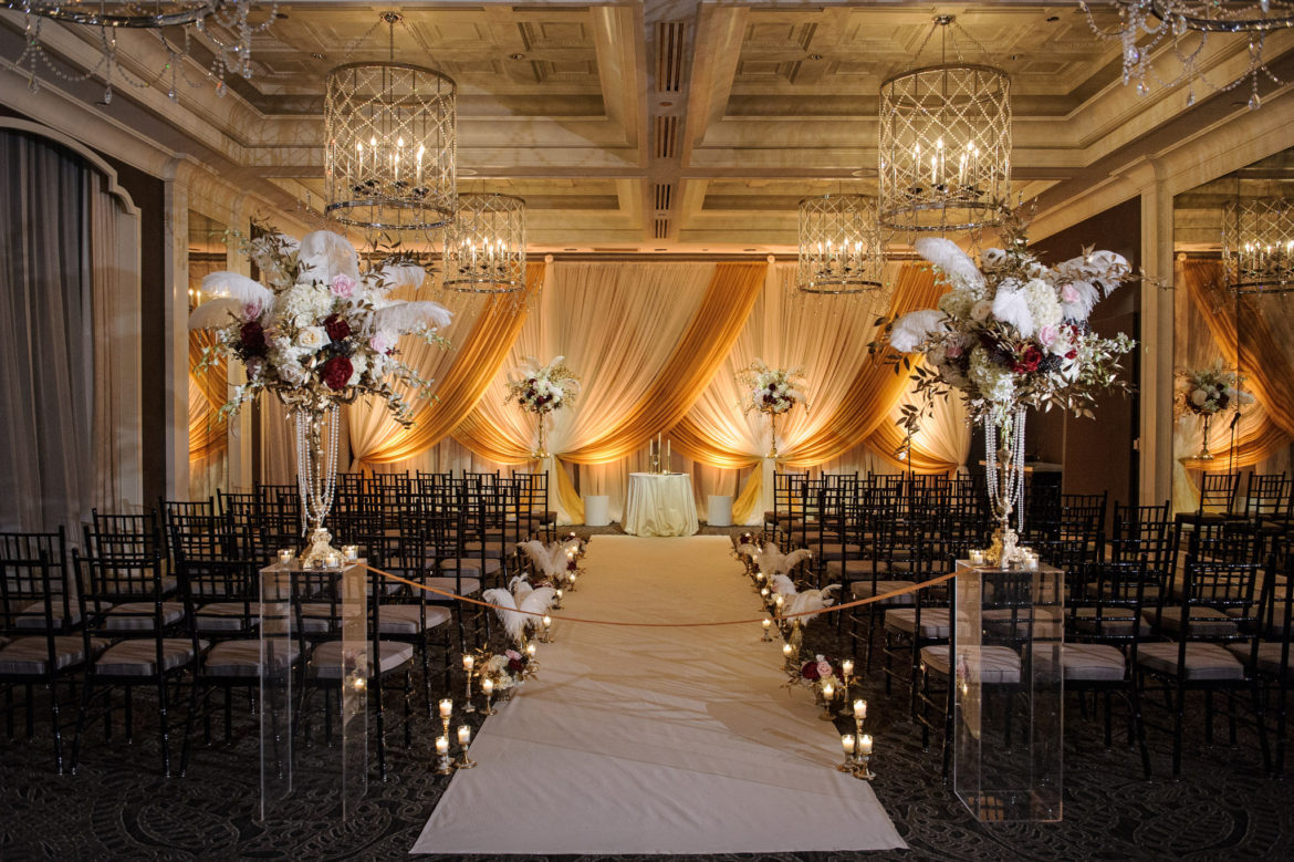 Elegant_Event_Lighting_Chicago_Waldorf_Astoria_Wedding_Ivory_Gold_Amber_Uplighting_Draping_Backdrop_Feathers_Gatsby_Ceremony