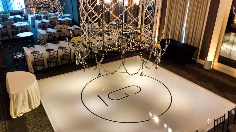 Elegant_Event_Lighting_Chicago_Waldorf_Astoria_Wedding_White_Dance_Floor_Cover_Monogram