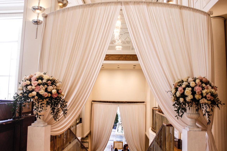 Elegant_Event_Lighting_Marriott_Peninsula_Hotel_Wedding_Chicago_Entrance_Draping_ivory