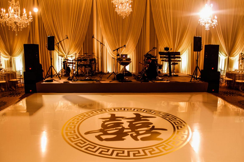 Elegant_Event_Lighting_Marriott_Peninsula_Hotel_Wedding_Chicago_Gold_Vinyl_Monogram_Dance_floor_Ivory_Draping