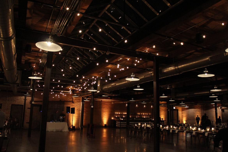Elegant_Event_Lighting_Morgan_Manufacturing_Wedding_Cafe_Lights_over_Dance_Floor_Amber-Uplighting