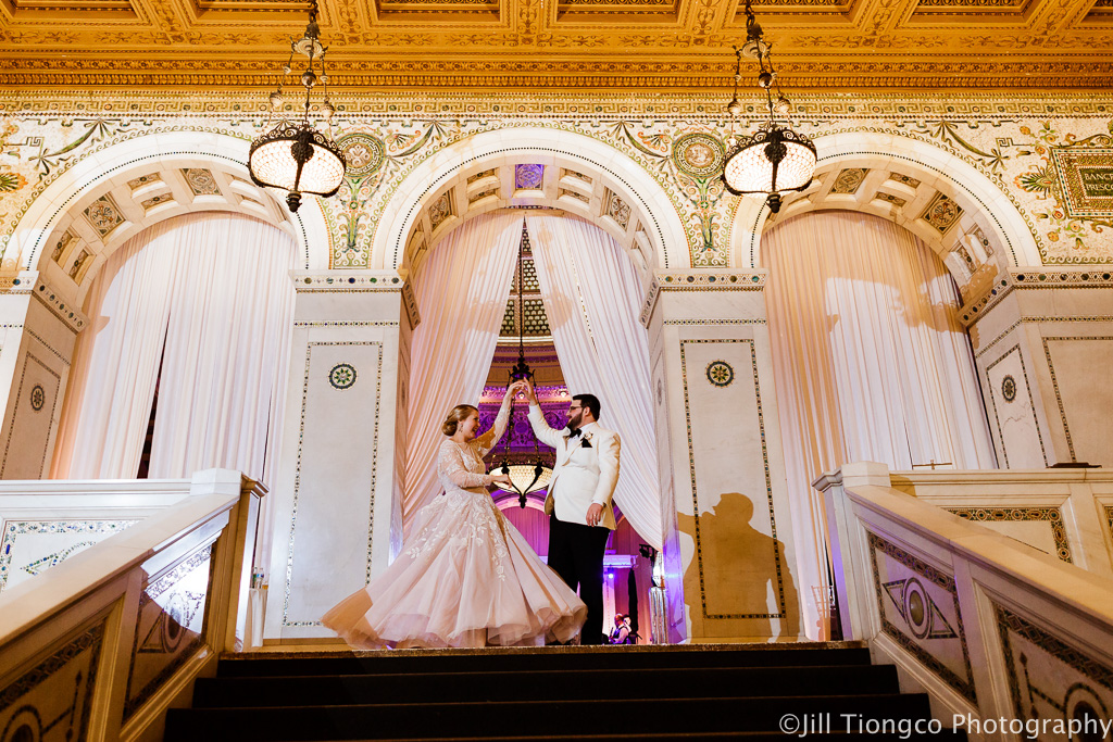 Elegant_Event_Lighting_Chicago_Cultural_Center_Preston_Bradley_Hall_Bride_Groom_Dance_Entrance_Draping