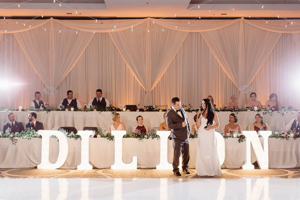 Elegant_Event_Lighting_Chicago_Hilton_Oak_Brook_Hills_Wedding_Marquee_Letters_White_Dance_Floor_Ivory_Draping_Backdrop