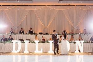 Elegant_Event_Lighting_Chicago_Hilton_Oak_Brook_Hills_Wedding_Marquee_Letters_White_Dance_Floor_Ivory_Draping_Backdrop