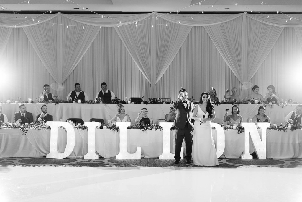 Elegant_Event_Lighting_Chicago_Hilton_Oak_Brook_Hills_Wedding_Toast_White_Dance_Floor_BAckdrop
