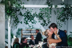 Elegant_Event_Lighting_Edgewater_Hotel_Wisconsin_Wedding_First_Look_Kiss_Reception_White_Room_Draping