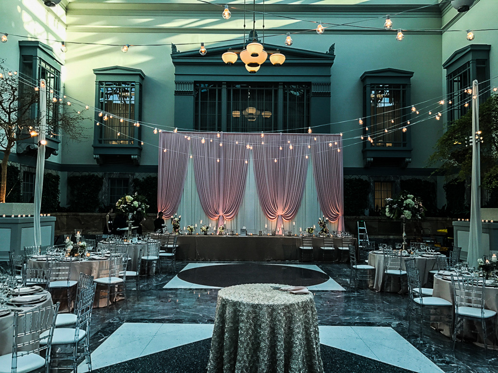 Elegant_Event_Lighting_Chicago_Wedding_Reception_Harold_Washington_Backdrop_Pink_Cafe_Lighting_String_Lighting