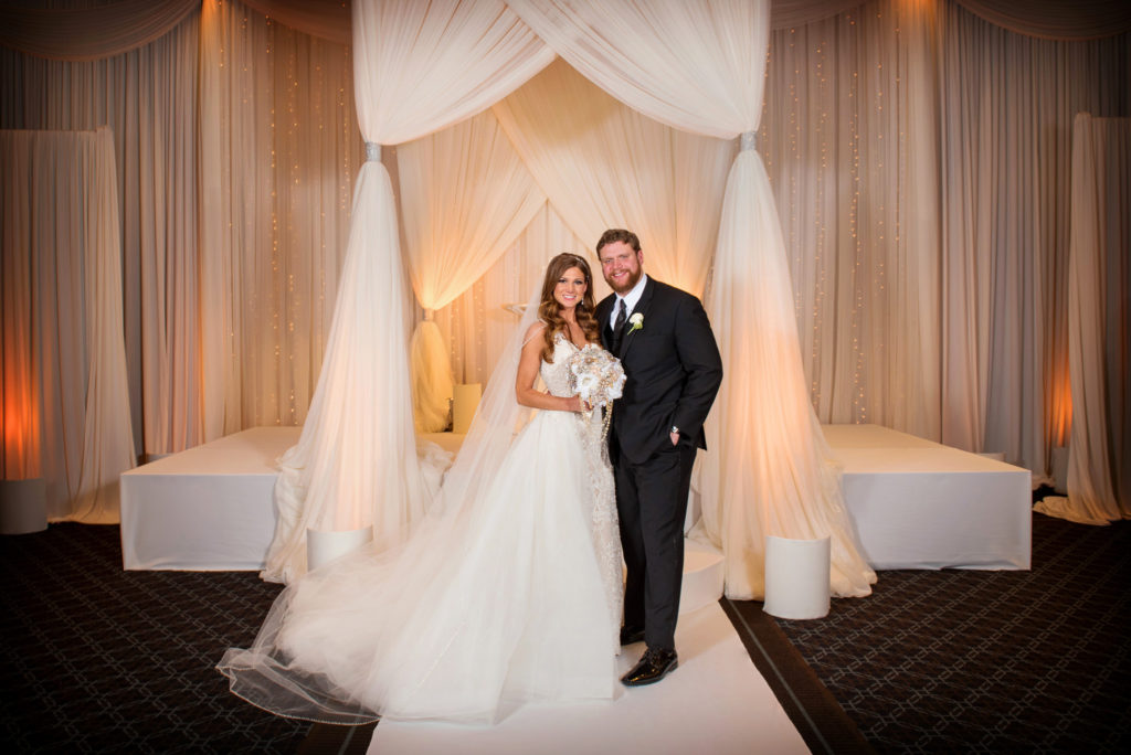 Elegant_Event_Lighting_Hotel_Arista_Naperville_Wedding_Portrait_Chuppah_amber_Ivory_Bridal_Canopy