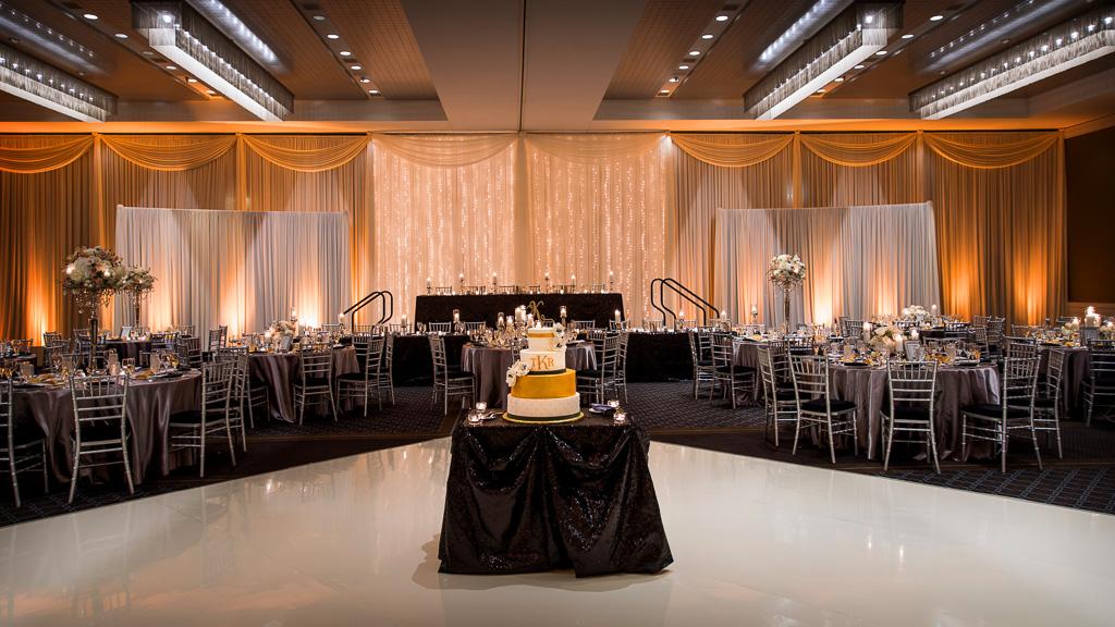 Elegant_Event_Lighting_Hotel_Arista_Naperville_Wedding_White_Vinyl_Dance_Floor_Fairy_Light_Ivory_Draping_Amber_Uplighting